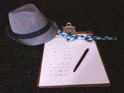 A hat, bow-tie, and some math on a clipboard